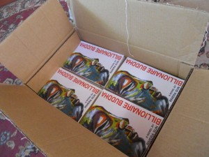 Billionaire Buddha is flying through the mail to readers everywhere!