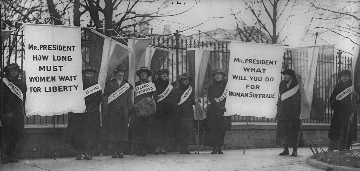 """Women suffragists picketing in front of the White house"". Licensed under Public Domain via Commons."